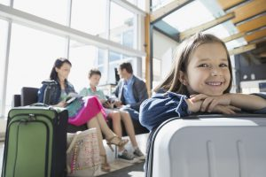 Portrait of smiling girl waiting in airport