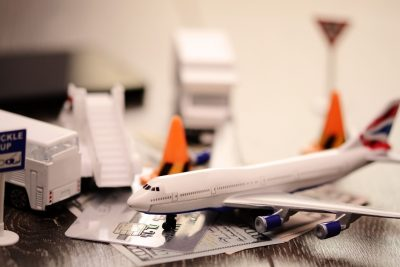 Buying tickets for a new flight with toy plane and money